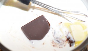 Bittersweet chocolate and butter are whisked in after the milk has thickened.