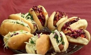 Red slaw is on the dogs in the upper right portion of the photo.